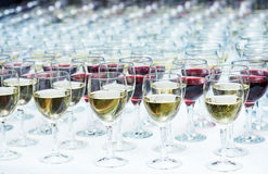 Glasses with wine in row Stock Photography