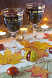 Glasses of wine on the table. Glasses of wine on a celebratory autumn table Royalty Free Stock Photography