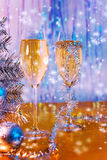 Glasses with wine, tinsel, Christmas tree and toys Stock Image