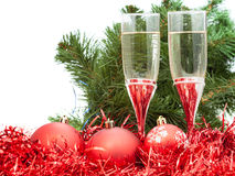 Glasses of wine and tree and red Christmas balls royalty free stock photo