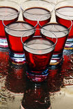 Glasses of wine on a wet mirror. Stock Image