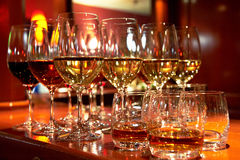 Glasses of wine and whiskey Royalty Free Stock Image