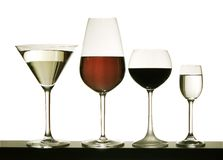 Glasses with wine on a white background. Glasses with color wine on a white background Royalty Free Stock Photography