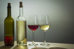 Glasses of Wine and bottle on table Stock Photography