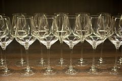 Glasses for wine on a wooden table. royalty free stock photos