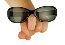 Glasses on a womanish hand Stock Photography