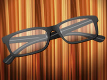 Glasses on wooden desk Royalty Free Stock Image