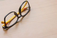 Glasses on the wooden Stock Images