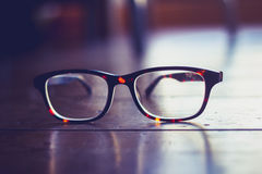 Glasses on a wooden floor. Pair of glasses on a wooden floor royalty free stock photography
