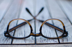 Glasses on a wooden table Stock Images
