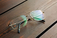 Glasses. On a wooden table Stock Photography