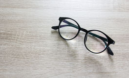 Glasses on wooden table Royalty Free Stock Image