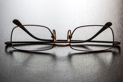 Glasses on a wooden table Royalty Free Stock Images