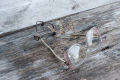 Glasses on a wooden table Royalty Free Stock Photography