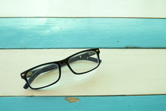 Glasses on wooden table Stock Image