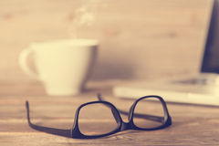 Glasses on wooden work table Stock Photos