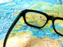 Glasses on world Map. Close up glasses on world Map royalty free stock photo