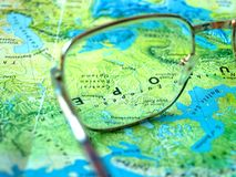 Glasses on world Map stock photography