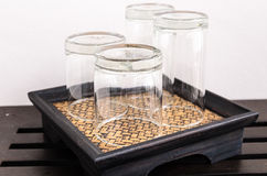Glasses on the woven coaster. 4 glasses on the woven coaster stock images