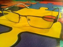 Glasses with yellow table Royalty Free Stock Photography