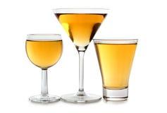 Glasses of yellow wine Stock Photos