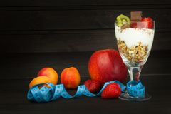 Glasses with yogurt and muesli. Healthy dietary supplements for athletes. Cheerios for breakfast. Muesli and fruit. The diet for weight loss. Muesli to eat royalty free stock images