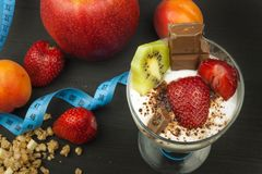 Glasses with yogurt and muesli. Healthy dietary supplements for athletes. Cheerios for breakfast. Muesli and fruit. The diet for weight loss. Muesli to eat stock photography