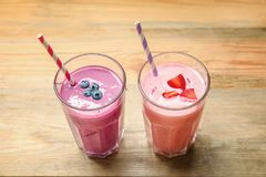 Glasses with yummy smoothie. On wooden table Stock Photos