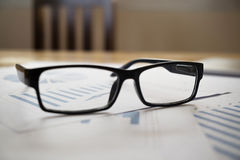 Glassess of financial reports. Royalty Free Stock Images