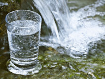 Glassfull. Glass of cold water in falls Royalty Free Stock Image