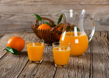 Glassfuls and pitcher of orange juice Stock Images
