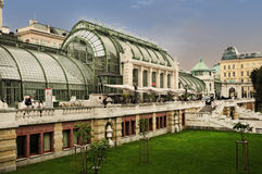 Glasshouse. Art nouveau glasshouse, a part of Hofburg, where you can see tropical trees Stock Photo