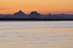 Glasshouse Mountains at sunset. The Glasshouse Mountains at sunset taken from across the Pumicestone Passage, Bribie Island, Australia Royalty Free Stock Photos