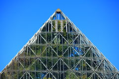 Glasshouse pyramid top. Top of the tropical plant house pyramid (Sydney Royal Botanic Gardens) - set against clear blue sky Stock Photography