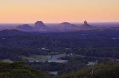 Glasshouses at sunrise. Sunrise over the Glasshouse Mountains on Queensland's Sunshine Coast, Australia Stock Images