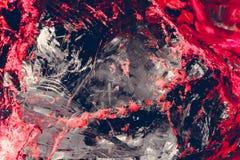 glasspaanders van grijze kleur met gebroken plonsen van heldere rode en roze kleur, Royalty-vrije Stock Foto