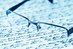Glassses and handwritten letter Royalty Free Stock Images