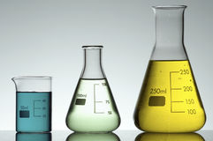 Glassware. Two flasks and a beaker to the light Stock Image