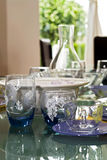 Glassware. Adorable glassware reflecting on equally texturized, shining table Royalty Free Stock Photos