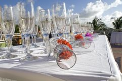 Glassware. Table with backlit flute glasses on the main garden terrace at Sandals Grande Resort in St. Lucia in the West Indies stock images