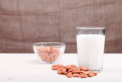 Glassware almond milk on the table side view Stock Image