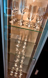 Glassware cabinet. Modern cabinet filled with different types of glass for different types of drinks Stock Photo