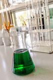 Glassware with chemical liquid in laboratory Stock Photo