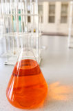 Glassware with chemical liquid in laboratory Stock Image