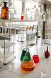 Glassware with chemical liquid in laboratory Royalty Free Stock Images