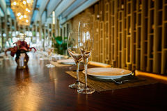 Glassware and cutlery on dining-table Royalty Free Stock Photography
