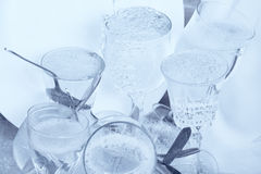 Glassware,cutlery and dishes in the kitchen sink Royalty Free Stock Photo