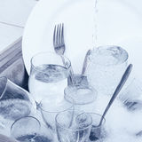 Glassware,cutlery and dishes in the kitchen sink Royalty Free Stock Photos