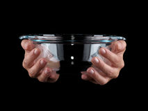 Glassware. Empty bowl on a black background. Glassware. Hands holding empty bowl on a black background Stock Photography