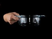 Glassware. Empty bowl on a black background. Glassware. Hands holding empty bowl on a black background Stock Photos